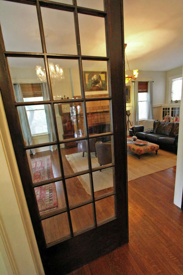 Dara Anderson stripped white paint from the glass-panel pocket doors from the entry to the living room and stained the wood brown. Photo: Danny Warner, For The Express-News