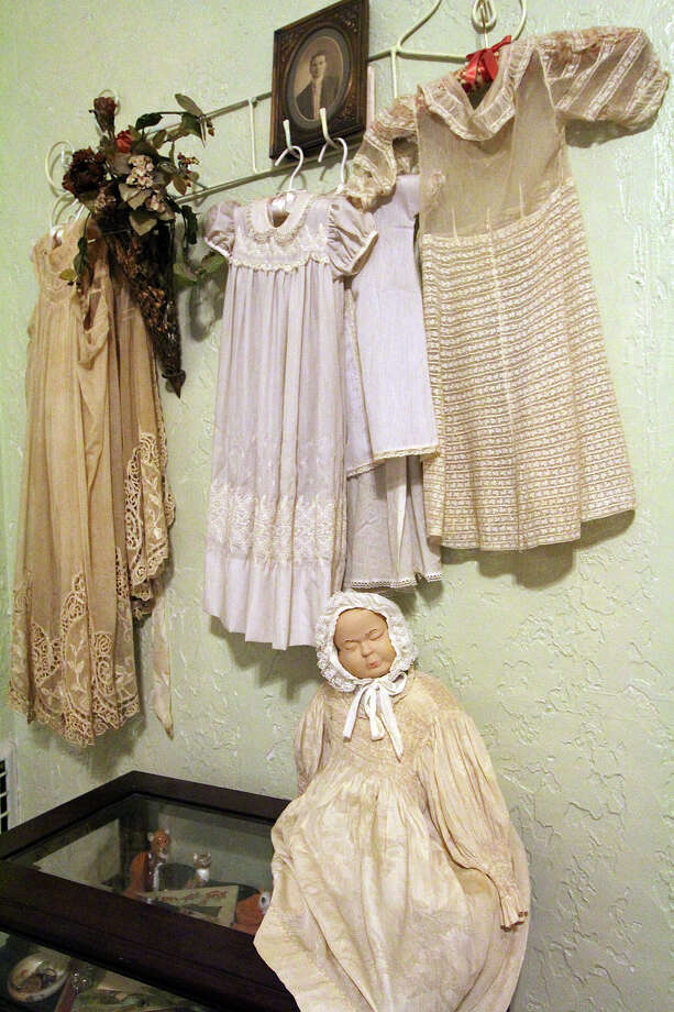 Christening dresses from family members are displayed in a guest bedroom of Dara Anderson and Jerry Lockey's Beacon Hill home. Photo: Danny Warner, For The Express-News