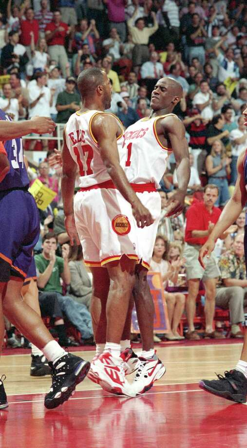 Rockets teammate Mario Elie, left, gets a taste of the fire with which Vernon Maxwell played. Photo: Kerwin Plevka, HC Staff / Houston Chronicle