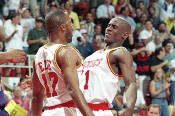 Rockets teammate Mario Elie, left, gets a taste of the fire with which Vernon Maxwell played.