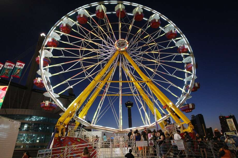 People line up to board the 100-foot Giant Wheel on the first day of the Fiesta Carnival by the Alamodome in 2012. Photo: Jerry Lara, Express-News