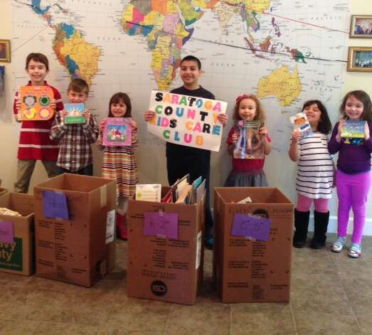 The Saratoga County Kids Care Club members collected more than 1,000 used books for their 2014 BookShare Service Project and donated them to local schools and organizations earlier this month. Sorting and counting the books, from left, are Jonathan Jones, Wesley Vedder, Hannah Vedder, Aydin Sajjad, Ariel Jones, Ariana Sajjad and Isabella Fuda.
