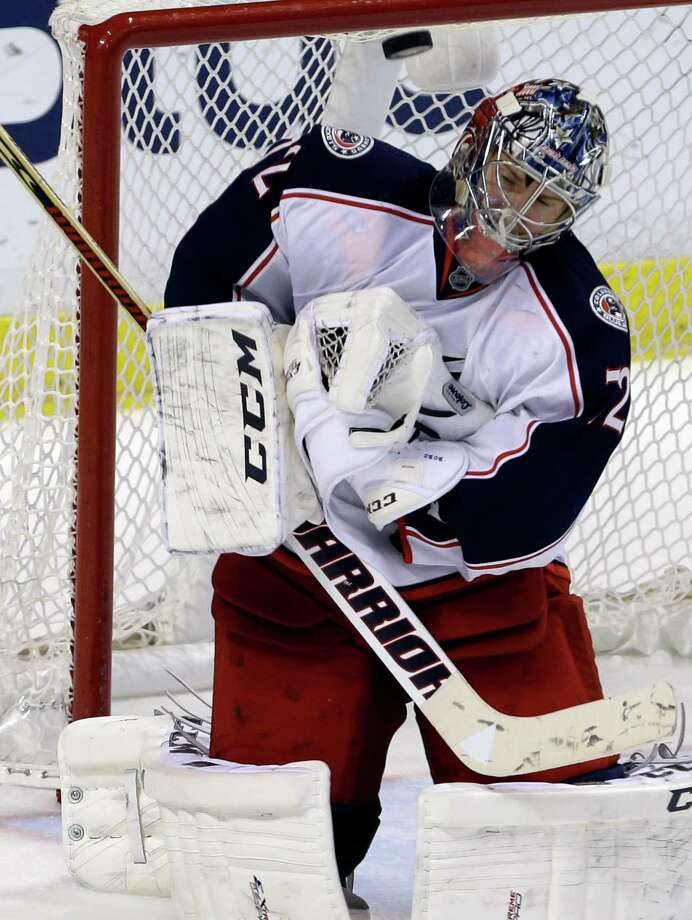 Columbus Blue Jackets goalie Sergei Bobrovsky stops the puck in the third period of a hockey game against the Florida Panthers, Saturday, April 12, 2014, in Sunrise, Fla. The Blue Jackets defeated the Panthers 3-2. (AP Photo/Lynne Sladky) ORG XMIT: FLLS111 Photo: Lynne Sladky / AP