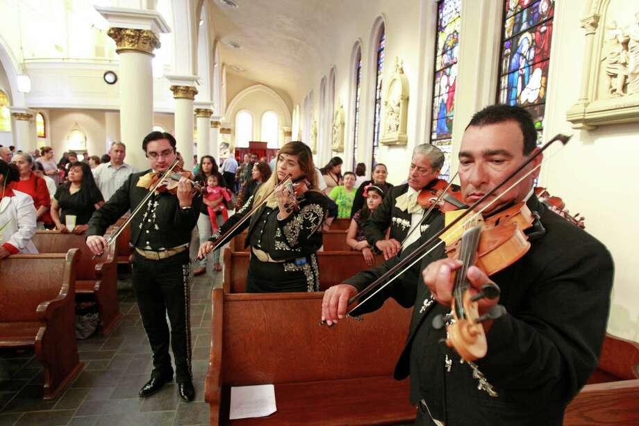 Bene Gutierrez, right, performs with other members of Mariachi Norteño during the Mariachi Mass on Palm Sunday at St. Joseph Catholic Church in the Sixth Ward near downtown Houston. Photo: Melissa Phillip, Staff / © 2014  Houston Chronicle