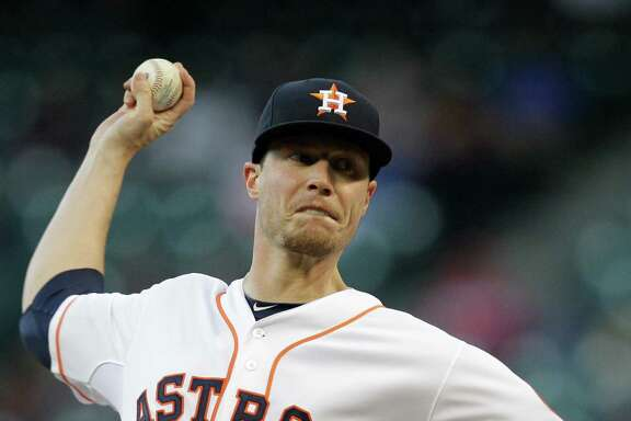 Houston Astros Lucas Harrell pitches against the  Kansas City Royals during the first inning at Minute Maid Park Tuesday, April 15, 2014, in Houston. All players are wearing 42 on their jerseys for Jackie Robinson Day.