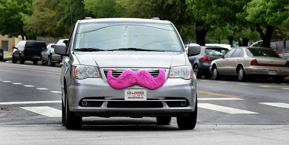 Festooned with the company's signature pink mustache, a Lyft car makes its way downtown. Photo: Bob Owen / San Antonio Express-News / © 2012 San Antonio Express-News