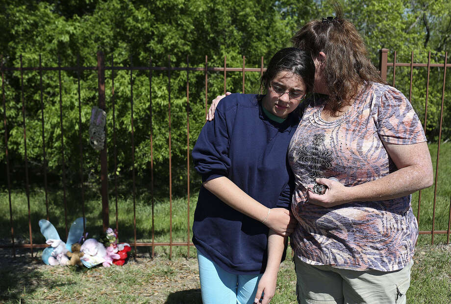 "Brittany Norwood, 13, and her mother, Jennifer Click, pay their respects near a memorial for Jada Craft outside the Avana Grove apartment complex in Universal City. They brought a bunny wreath. ""There is nothing you can say to fix it. How do you fix someone's shattered heart?"" Click said. They came ""just so the family knows they are not alone."" Photo: Lisa Krantz / San Antonio Express-News / SAN ANTONIO EXPRESS-NEWS"