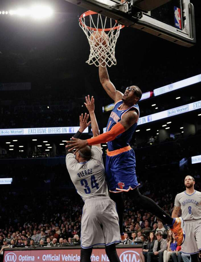 NEW YORK, NY - APRIL 15:  Amar'e Stoudemire #1 of the New York Knicks scores two in the second quarter against Paul Pierce #34 of the Brooklyn Nets at the Barclays Center on April 15, 2014 in the Brooklyn borough of New York City. NOTE TO USER: User expressly acknowledges and agrees that, by downloading and/or using this Photograph, user is consenting to the terms and conditions of the Getty Images License Agreement.  (Photo by Bruce Bennett/Getty Images) ORG XMIT: 182427645 Photo: Bruce Bennett / 2014 Getty Images