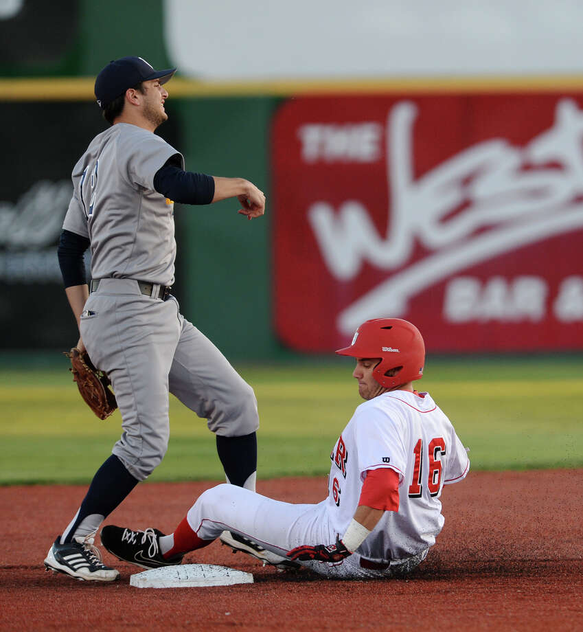 Lamar's Reed Seeley, No. 16, slides into second after being outed by Rice's Kirby Taylor, No. 12. The Lamar Cardinals baseball team played against Rice at Vincent-Beck Stadium on Tuesday. Photo taken Tuesday, 4/15/14 Jake Daniels/@JakeD_in_SETX Photo: Jake Daniels / ©2014 The Beaumont Enterprise/Jake Daniels