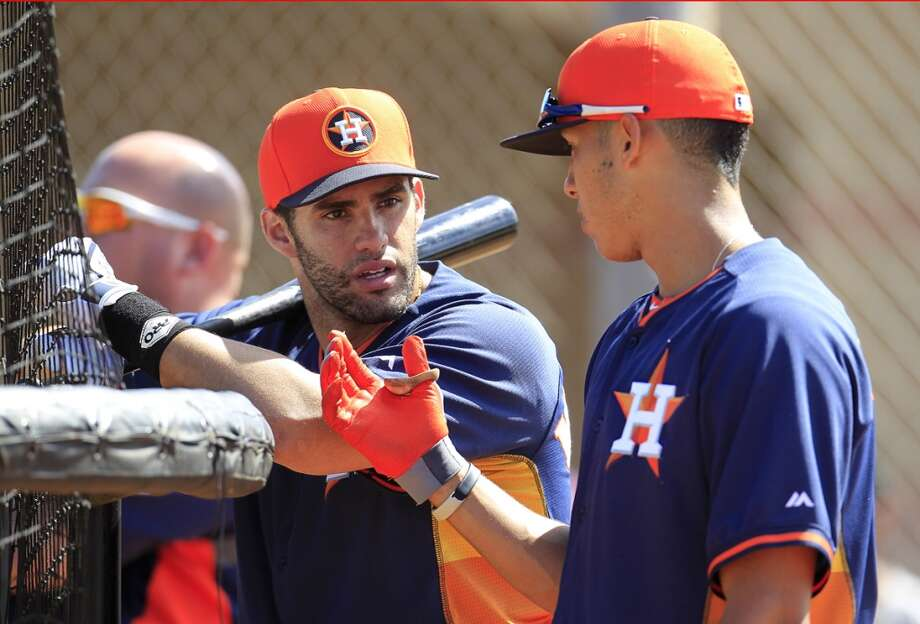 Houston Astros J.D. Martinez (20) talks with George Springer (79) during the first full-squad workout at the Houston Astros spring training facility,Thursday, Feb. 20, 2014. ( Karen Warren / Houston Chronicle ) Photo: Karen Warren, Houston Chronicle