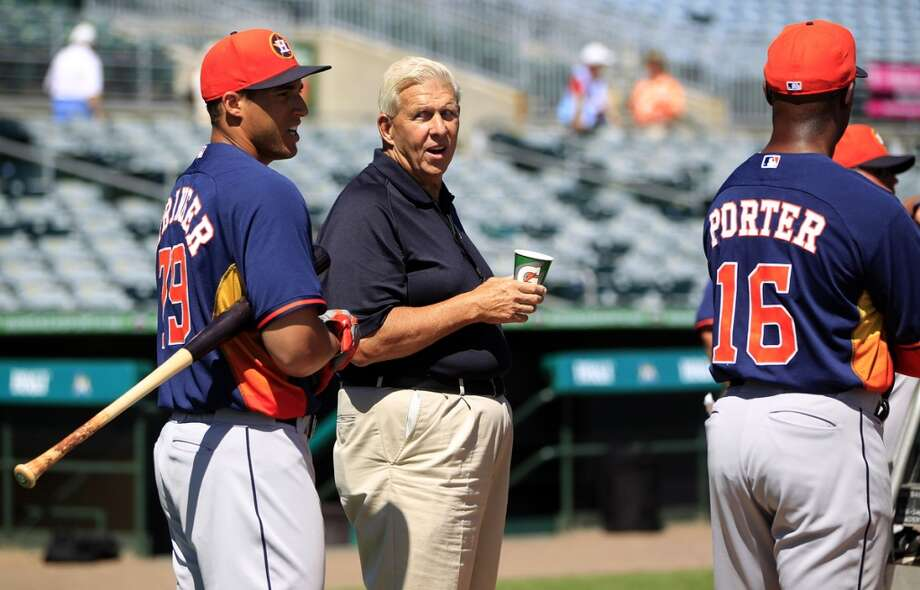NFL coach Bill Parcells chats with Houston Astros George Springer (79) and manager Bo Porter (16) during batting practice before a spring training game between the Houston Astros and the Marlins, Monday, March 3, 2014, in Jupiter. ( Karen Warren / Houston Chronicle ) Photo: Karen Warren, Houston Chronicle
