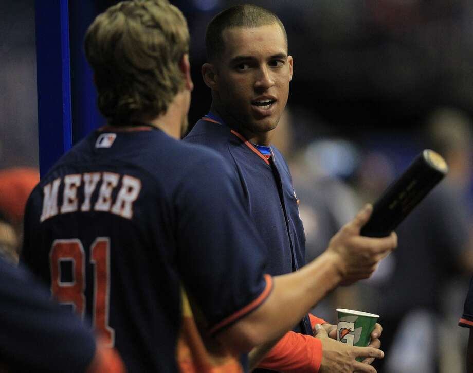 Houston Astros George Springer (79)  chats with Jonathan Meyer (81) in the dugout during the fourth inning of a spring training game baseball game at The Alamodome, Saturday, March 29, 2014, in San Antonio.  ( Karen Warren / Houston Chronicle  ) Photo: Karen Warren, Houston Chronicle