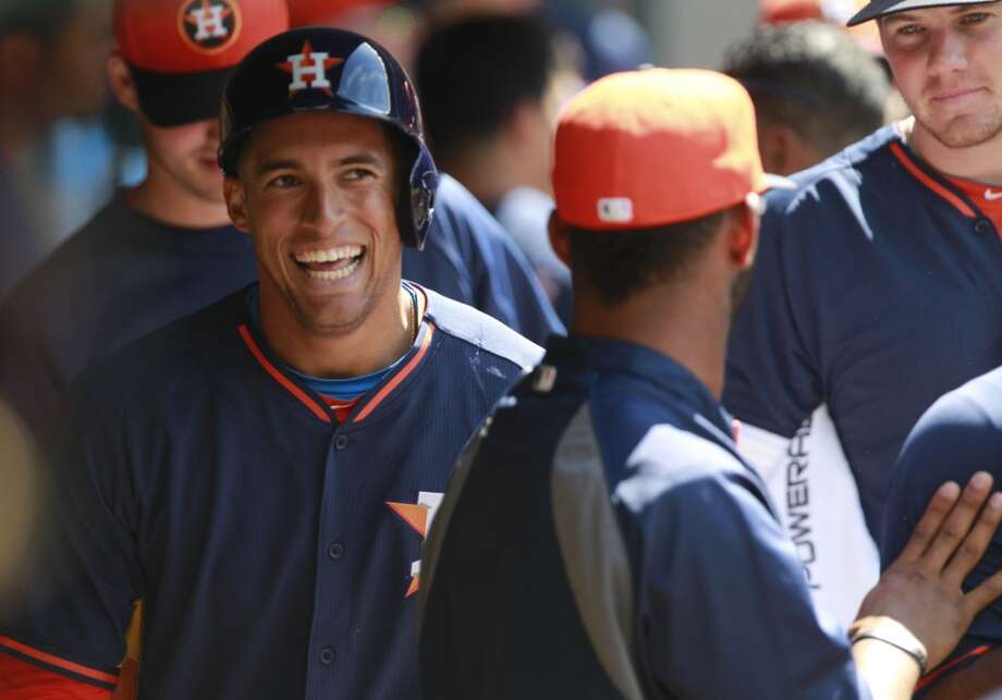 Houston Astros George Springer celebrates in dugout after scoring against the Rojos del Aguila de Veracruz during the seventh inning of an exhibition game at Minute Maid Park  Sunday, March 30, 2014, in Houston. ( Melissa Phillip / Houston Chronicle ) Photo: Melissa Phillip, Houston Chronicle