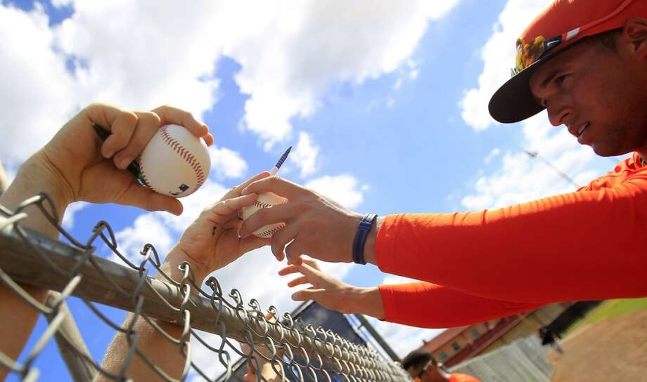 Houston Astros George Springer (79) signs autographs along a fence during the first full-squad workout at the Houston Astros spring training facility,Thursday, Feb. 20, 2014. ( Karen Warren / Houston Chronicle ) Photo: Karen Warren, Houston Chronicle