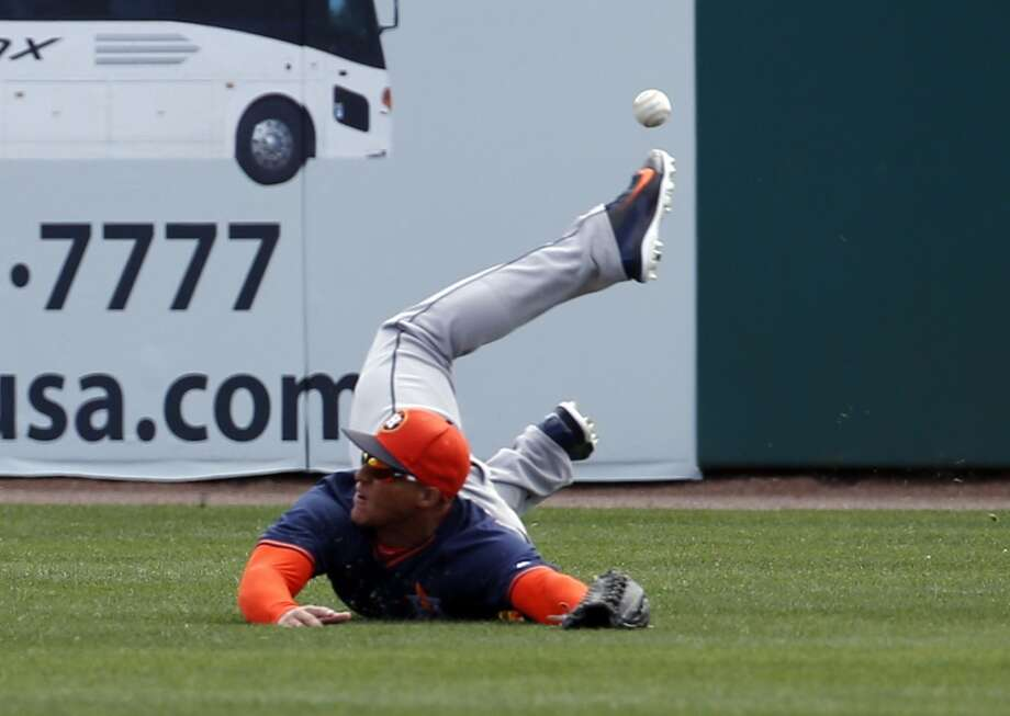 Houston Astros right fielder George Springer can't catch a hit by Washington Nationals' Ian Desmond in the first inning of a spring exhibition baseball game, Friday, March 7, 2014, in Viera, Fla. (AP Photo/Alex Brandon) Photo: Alex Brandon, Associated Press