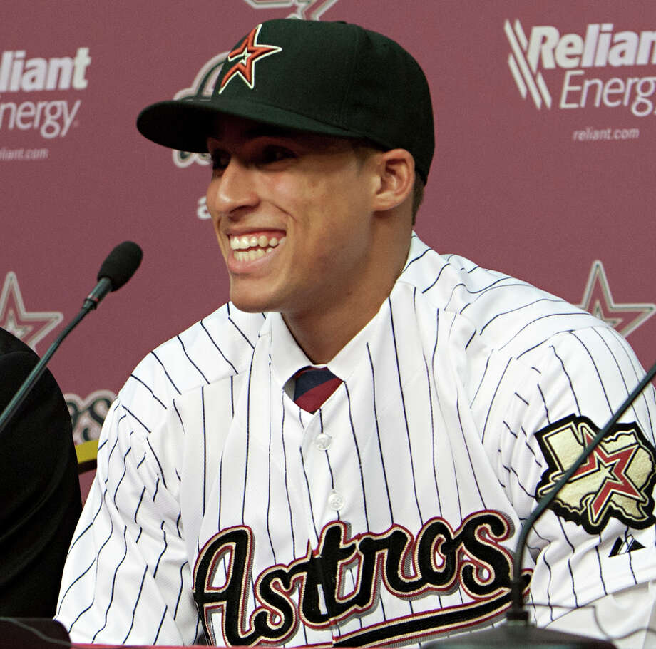 Outfielder George Springer is introduced as the Houston Astros' first round pick during a press conference at Minute Maid Park on August 19, 2011 in Houston, Texas.  (Photo by Bob Levey/Getty Images) Photo: Bob Levey, Getty Images / 2011 Getty Images