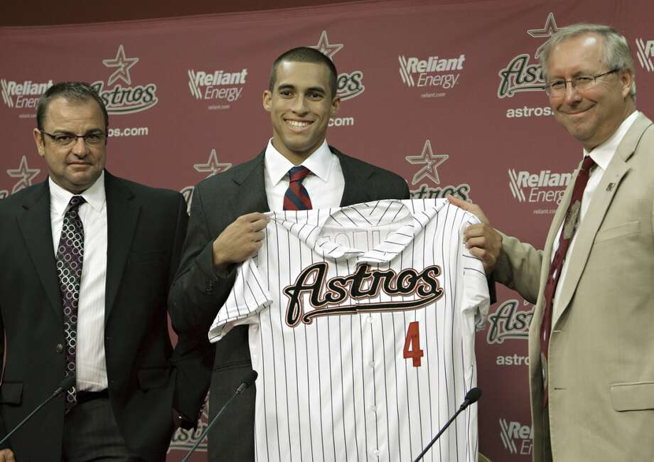 HOUSTON - AUGUST 19:  The Houston Astros announce that they have signed their first round pick, outfielder George Springer out of Connecticut at a press conference at Minute Maid Park on August 19, 2011 in Houston, Texas.  Spirnger is shown with Astros Assistant General Manager/DIrector of Scouting Bobby Heck (L) and Astros Amateur Scout John Kosciak. (Photo by Bob Levey/Getty Images) Photo: Bob Levey, Getty Images