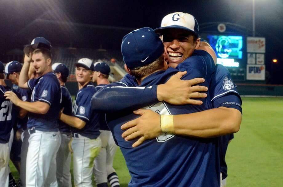 Connecticut's George Springer, Back, and Nick Walsh celebrate their 14-1 win over Clemson at an NCAA college baseball regional tournament game at Doug Kingsmore Stadium Monday, June 6, 2011, in Clemson, S.C. (AP Photo/ Richard Shiro) Photo: RICHARD SHIRO, Associated Press