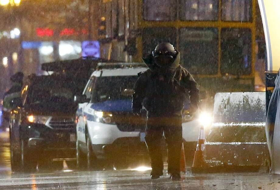A member of the bomb squad prepares for a controlled detonation at the Boston Marathon finish line in Boston, Tuesday, April 15, 2014. (AP Photo/Michael Dwyer) Photo: Michael Dwyer, Associated Press
