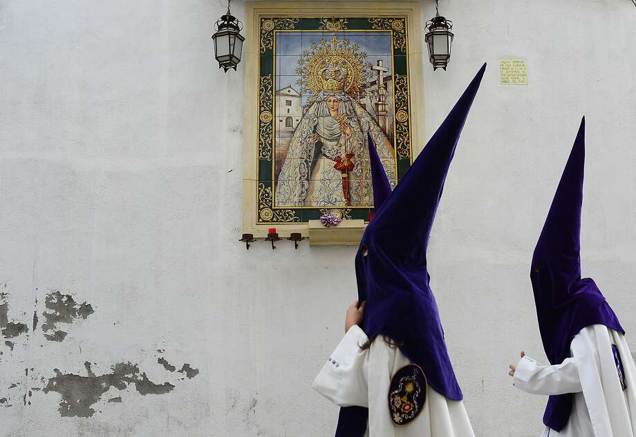 "Penitents from ""La Sangre"" brotherhood walk to the church prior to the Holy Week procession in Cordoba, southern Spain, Spain, Tuesday, April 15, 2014. Hundreds of processions take place throughout Spain during the Easter Holy Week(AP Photo/Manu Fernandez) Photo: Manu Fernandez, Associated Press"