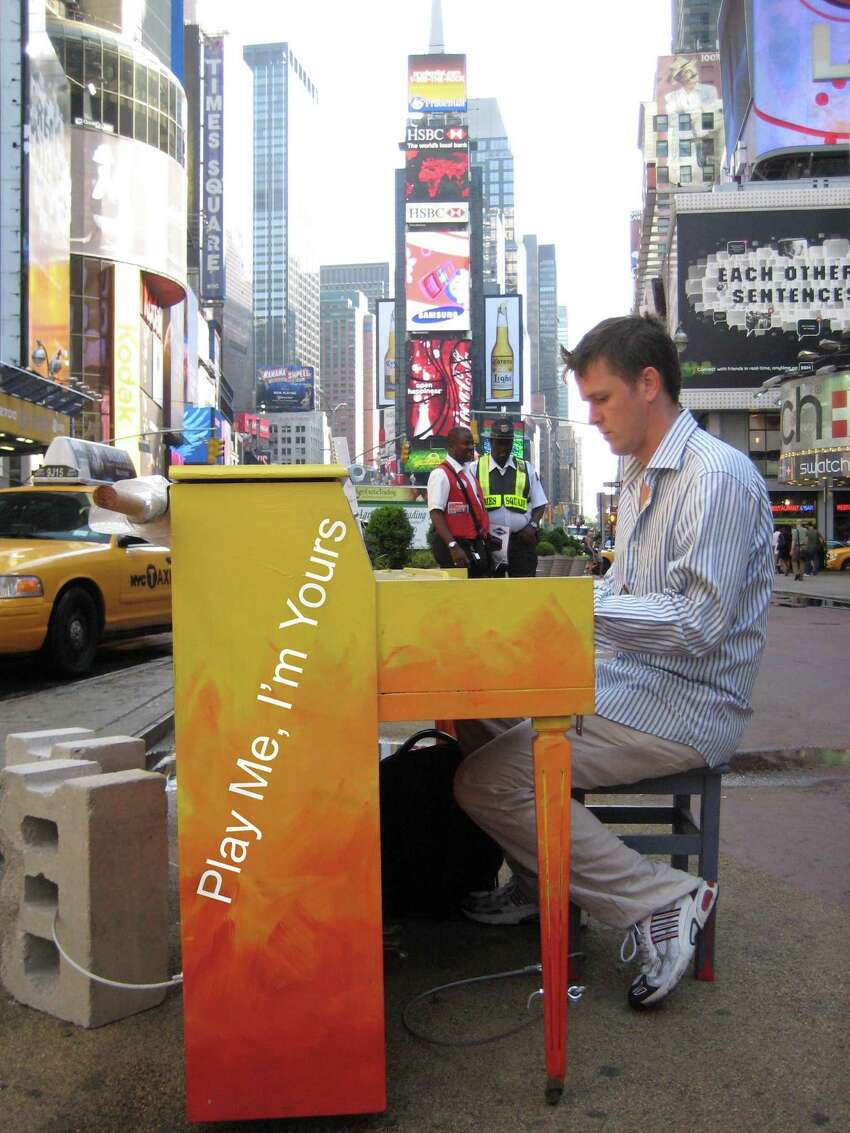 Photograph by Amarynth Sichel Artist Luke Jerram at one of his ?Play Me, I?m Yours? pianos in Times Square in Manhattan in 2010.