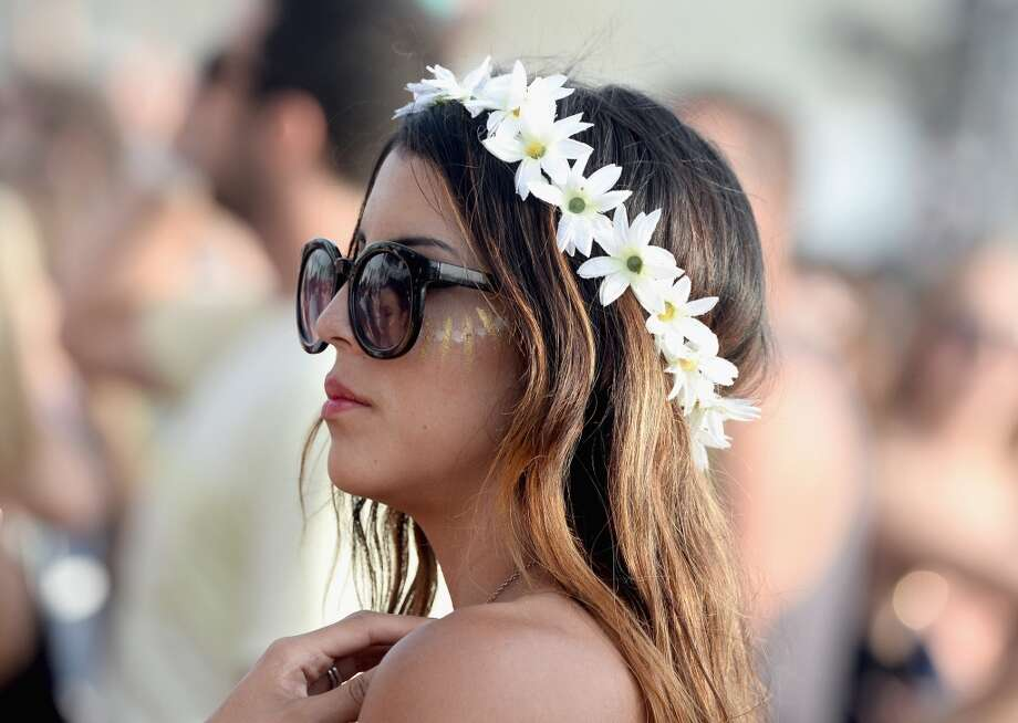 Flowers, floppy hats and other boring clichesWe thought flowers went the way of the Native American headdress. Meaning, we thought people would stop wearing them to festivals in 2014. Oh, well. Photo: Frazer Harrison