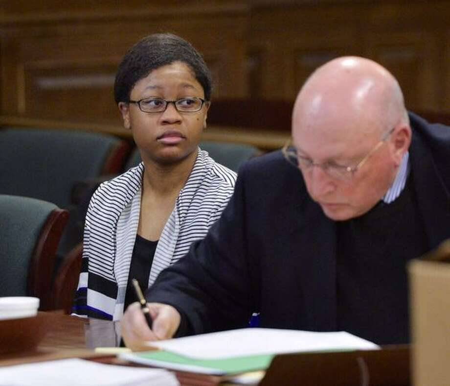 Trinity Copeland, 18, sits with her attorney, Michael Feit, as her trial gets underway. Copeland is charged with second-degree murder for allegedly killing her father. (Skip Dickstein / Times Union)