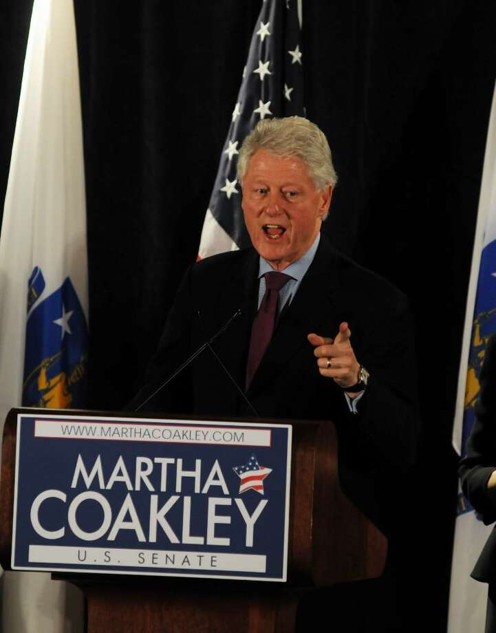 BOSTON - JANUARY 15: Former U.S. President Bill Clinton attends a rally for U.S. Senate democratic nominee Martha Coakley January 15, 2010 at the Fairmont Copley Plaza Hotel in Boston, Massachusetts. The seat of the late U.S Senator Edward M. Kennedy is being hotly contested by Republican nominee Scott Brown, forcing Democratic powerhouses to lend their support.  (Photo by Darren McCollester/Getty Images) *** Local Caption *** Bill Clinton Photo: Darren McCollester, Getty Images / 2010 Getty Images