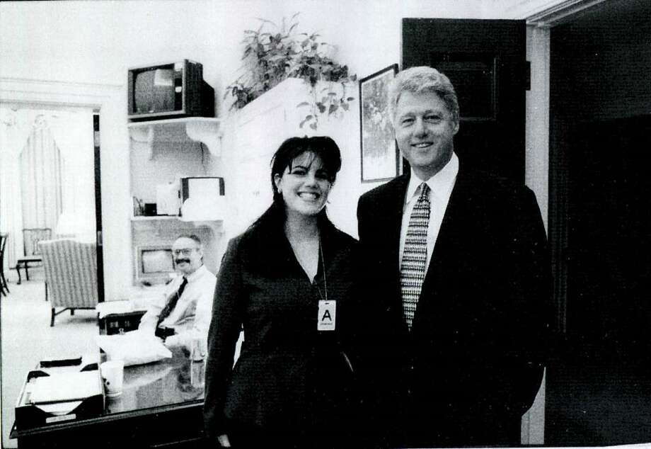 A photograph showing former White House intern Monica Lewinsky meeting President Bill Clinton at a White House function submitted as evidence in documents by the Starr investigation and released by the House Judicary committee September 21, 1998. Photo: Getty Images / Getty Images North America