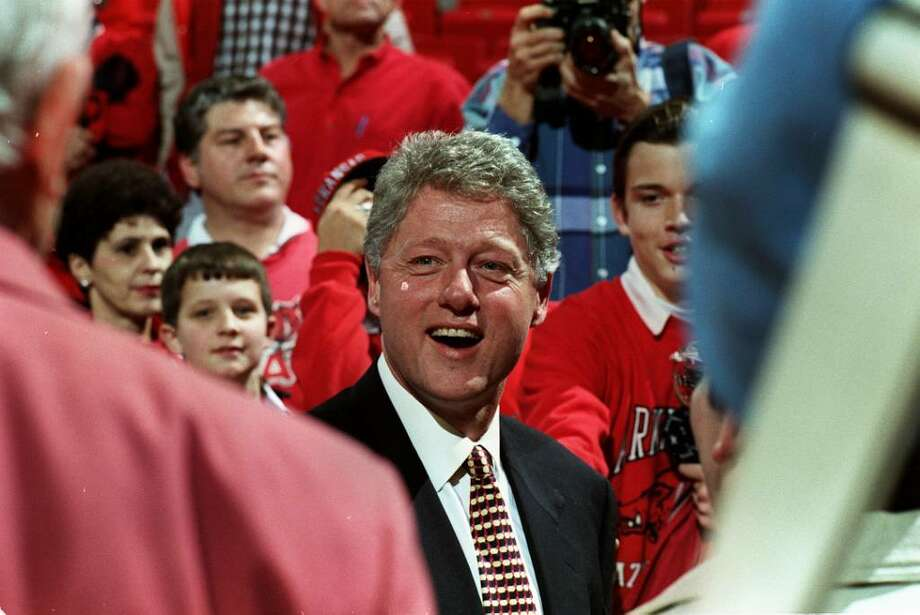 28 DEC 1993:  PRESIDENT BILL CLINTON SMILES DURING A NON-CONFERENCE GAME BETWEEN THE ARKANSAS RAZORBACKS AND THE TEXAS SOUTHERN TIGERS. Photo: Tom Ewart, Getty Images / Getty Images North America