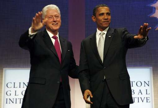 NEW YORK - SEPTEMBER 22:  U.S. President Barack Obama (L) and former President Bill Clinton acknowledge applause after Obama spoke at the Clinton Global Initiative at the Sheraton HotelSeptember 22, 2009 in New York City.  (Photo by John Angelillo-Pool/Getty Images) *** Local Caption *** Bill Clinton;Barack Obama Photo: Pool, Getty Images / 2009 Getty Images
