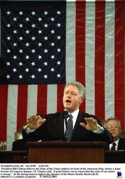 """Washington, Dc - 01/19/99 (670.729) President Bill Clinton Delivers The State Of The Union Address In Front Of The American Flag Before A Joint Session Of Congress January 19. Clinton Said, """"I Stand Before You To Report That The State Of Our Union Is Strong."""" In The Background At Right Is The Speaker Of The House Dennis Hastert,R-Il.  (Photo By Pool/Getty Images) Photo: Pool, Getty Images / Getty Images North America"""