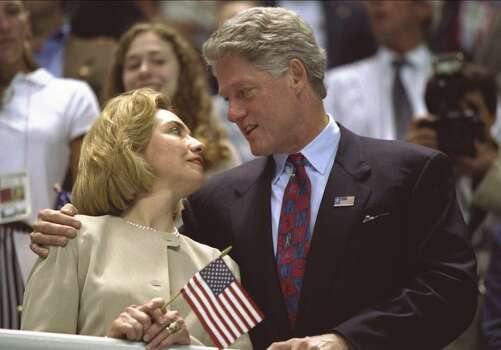 25 Jul 1996:  Hillary Clinton, left, and Bill Clinton look to one another as the USA women's 4x200m freestyle relay team wins the gold medal at the Georgia Tech Aquatic Center at the 1996 Centennial Olympic Games in Atlanta, Georgia. \ Mandatory Credit: Simon Bruty  /Allsport Photo: Simon Bruty, Getty Images / Getty Images Europe