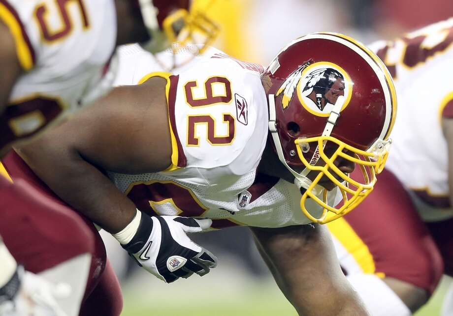 Washington Redskins: 9 arrests  Two months after allegedly punching a motorist in a road-rage incident, defensive tackle Albert Haynesworth (pictured) was indicted in April 2011 for allegedly fondling a restaurant worker's breast while slipping money into her shirt. Photo: Christian Petersen, Getty Images