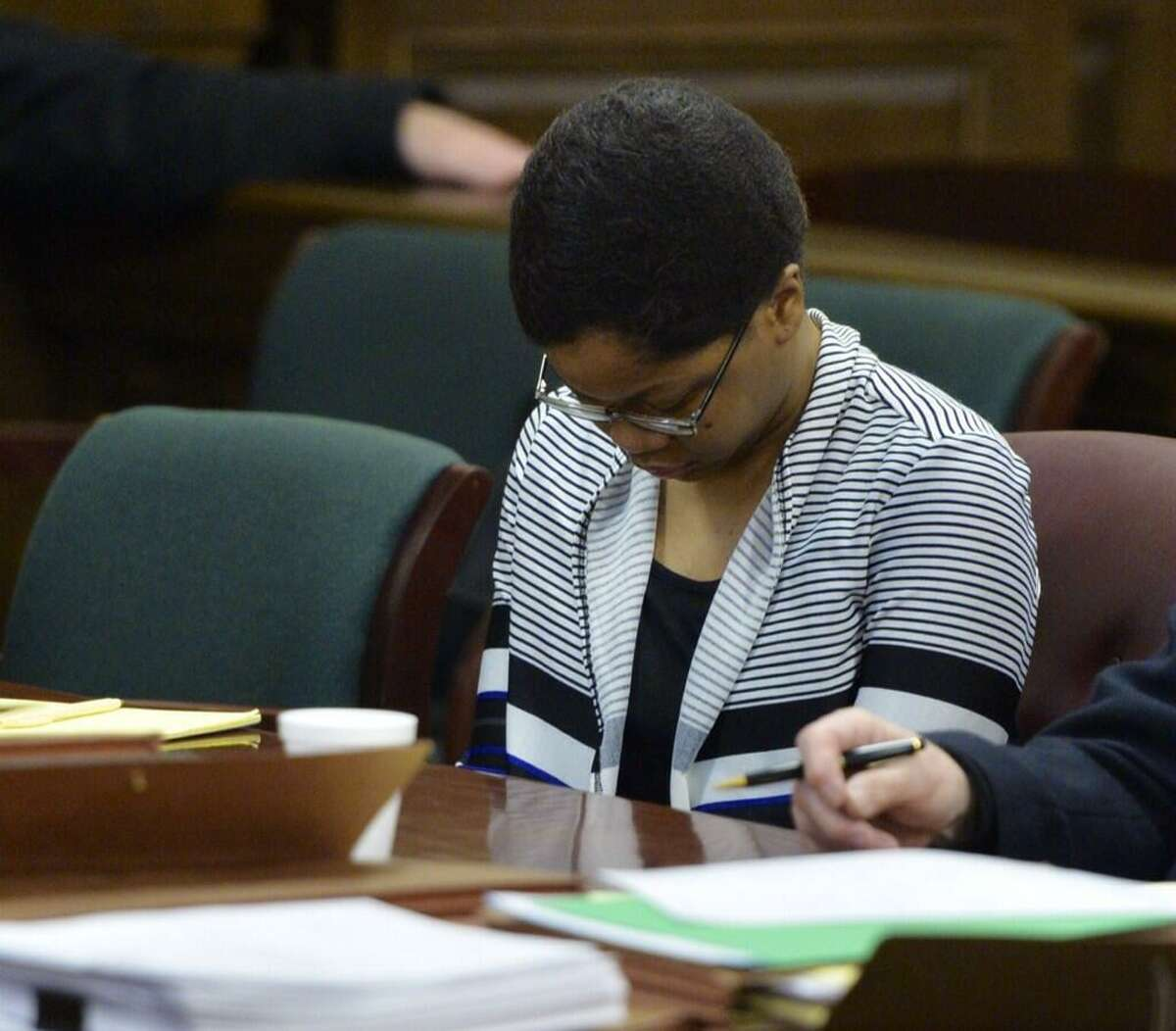 Trinity Copeland, 18, looks down as opening arguments get underway Wednesday at her second-degree murder trial in Rensselaer County Court. Copeland is accused of killing her father. (Skip Dickstein / Times Union)