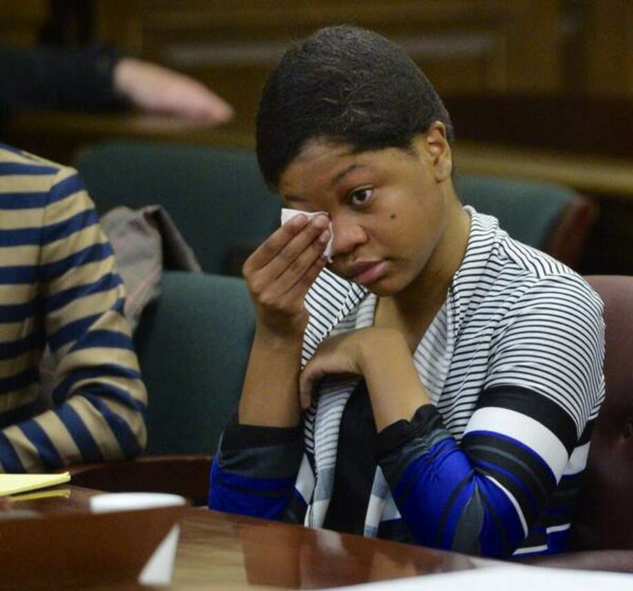 Trinity Copeland, 18, wipes tears at the opening of her trial in Rensselaer County Court. Copeland is accused of killing her father. (Skip Dickstein / Times Union)