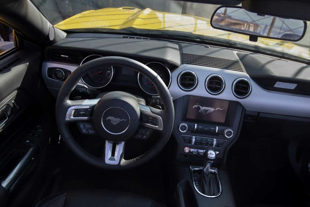 The Ford Motor Company introduces the all-new 2015 Mustang convertible on the 86th floor observation deck of the Empire State Building during the New York International Auto Show, Wednesday, April 16, 2014, in New York. (AP Photo/John Minchillo) ORG XMIT: NYJM114