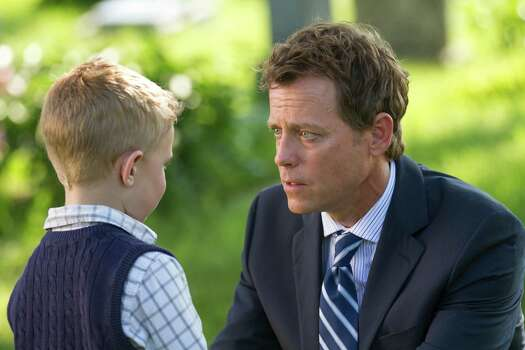 "Connor Corum, left, and Greg Kinnear star in ""Heaven Is for Real."" Photo: Allen Fraser, HOEP / Sony Pictures"