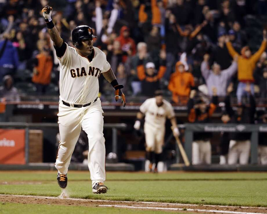 San Francisco Giants' Hector Sanchez runs down the first base line after driving in the game-winning run during the 12th inning of a baseball game against the Los Angeles Dodgers on Wednesday, April 16, 2014, in San Francisco. San Francisco won 3-2. Photo: Marcio Jose Sanchez, Associated Press