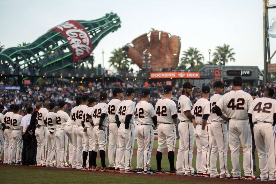 Members of the San Francisco Giants lineup on the field before the game against the Los Angeles Dodgers at AT&T Park. Photo: Ed Szczepanski, Reuters