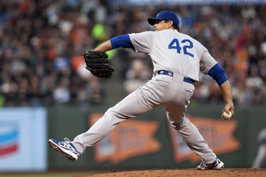 Los Angeles Dodgers starting pitcher Josh Beckett pitches against the San Francisco Giants during the first inning at AT&T Park. Photo: Ed Szczepanski, Reuters