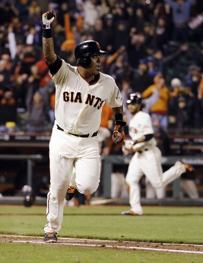 San Francisco Giants' Hector Sanchez runs down the first base line after driving in the game-winning run during the 12th inning of a baseball game against the Los Angeles Dodgers on Wednesday, April 16, 2014, in San Francisco. San Francisco won 3-2.  (AP Photo/Marcio Jose Sanchez) Photo: Marcio Jose Sanchez, Associated Press