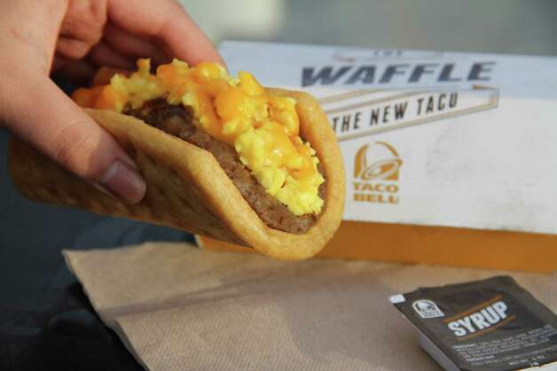 "Waffle Taco with Bacon from Taco Bell: Fluffy scrambled eggs, bacon and ""real Cheddar cheese"" tucked in a folded-over toaster oven waffle, served with a side of ""sweet syrup."" They're not even trying to swerve us into thinking it's maple syrup. Points for honesty.Total calories: 320. Fat grams: 18. Sodium: 670 mg. Carbs: 28 g. Dietary fiber: 1. Protein: 13 g. Manufacturer's suggested retail price $1.99.What Hoffman says:The Waffle Taco with Bacon is small. Think of a frozen waffle from the supermarket, folded into a makeshift taco. Hoffman's just getting started. Check out what else he had to say about the breakfast item."