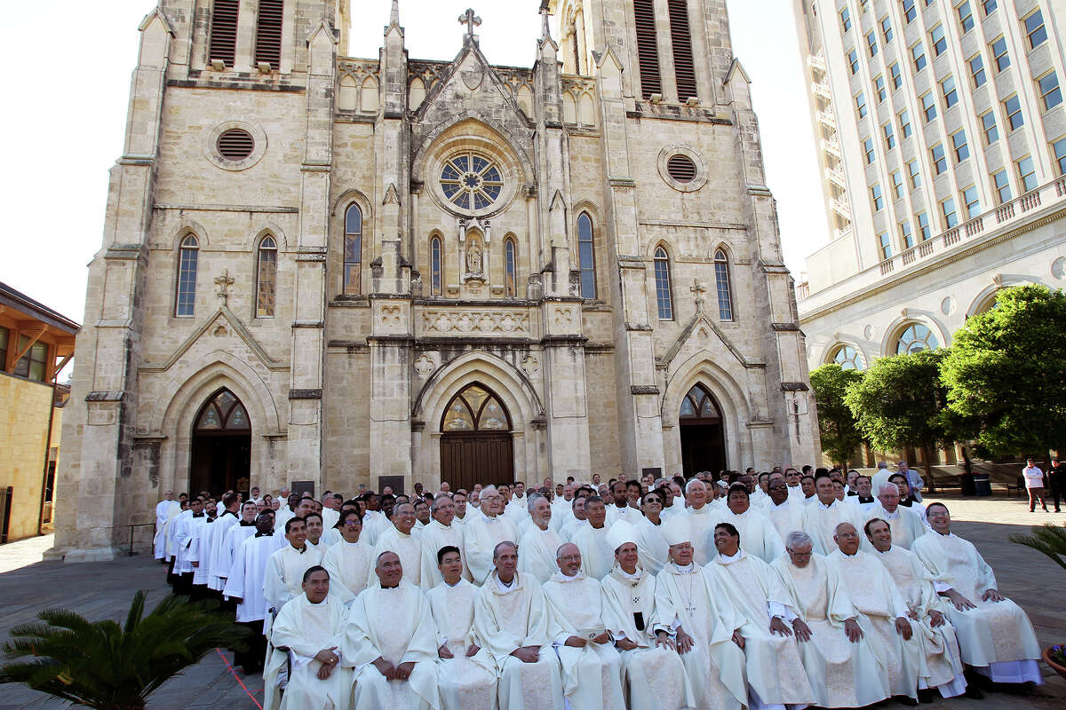 Area Catholic priests gather for a group photo before mass as Archbishop Gustavo Garcia-Siller officiates during the blessing of oils for the Archdiocese during the Chrism Mass at San Fernando Cathedral on April 15, 2014.