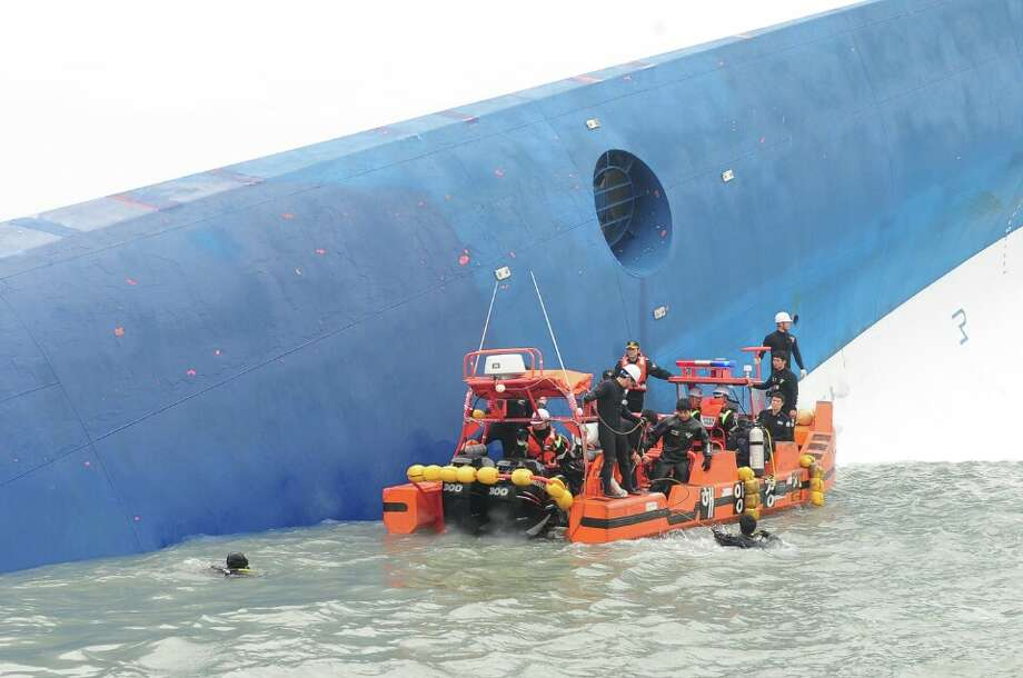 JINDO-GUN, SOUTH KOREA - APRIL 16: In this handout image provided by the Republic of Korea Coast Guard, the rescue work by members of the Republic of Korea Coast Guard continues around the site of ferry sinking accident off the coast of Jindo Island on April 16, 2014 in Jindo-gun, South Korea.  Four people are confirmed dead and almost 300 are reported missing. The ferry identified as the Sewol is reported to have been carrying around 470 passengers, including students and teachers, as it travelled to Jeju island. (Photo by The Republic of Korea Coast Guard via Getty Images) ORG XMIT: 485554013 Photo: Handout, Getty / 2014 Republic of Korea Coast Guard