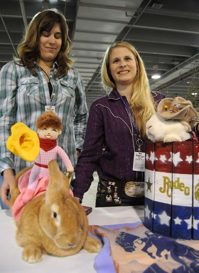 Sarah Elam and Lauren West and their rabbits Weasley and Houdini await judging at the rabbit and cavy costume contest at the Houston LIvestock Show and Rodeo Saturday  March 15, 2014. The pair won 1st place in the contest. (Dave Rossman photo) Photo: Dave Rossman, For The Houston Chronicle