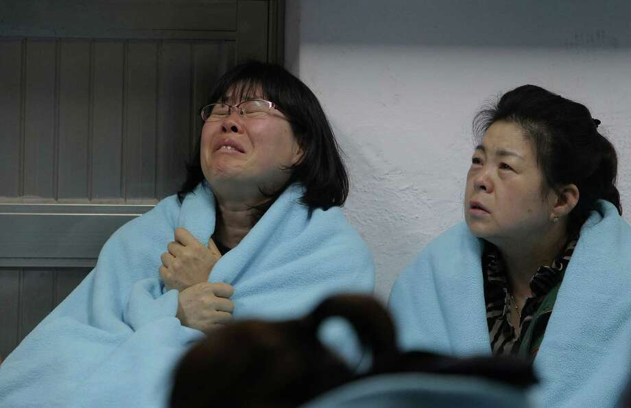 JINDO-GUN, SOUTH KOREA - APRIL 16:  Relatives weep as they wait for missing passengers of a sunken ferry at Jindo port on April 16, 2014 in Jindo-gun, South Korea. Four people are confirmed dead and almost 300 are reported missing. The ferry identified as the Sewol is reported to have been carrying around 459 passengers, including students and teachers, as it travelled to Jeju island.  (Photo by Chung Sung-Jun/Getty Images) ORG XMIT: 485554013 Photo: Chung Sung-Jun, Getty / 2014 Getty Images