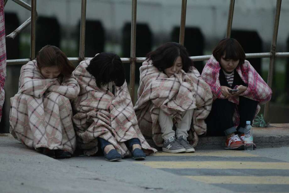 JINDO-GUN, SOUTH KOREA - APRIL 16:  Relatives of missing people wait at a Jindo port on April 16, 2014 in Jindo-gun, South Korea. Two people are dead, and more than ninety are missing as reported. The ferry identified as the Sewol was carrying about 470 passengers, including the students and teachers, traveling to Jeju island.  (Photo by Chung Sung-Jun/Getty Images) ORG XMIT: 485554013 Photo: Chung Sung-Jun, Getty / 2014 Getty Images
