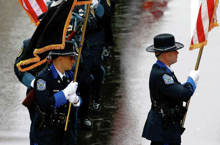 BOSTON, MA - APRIL 15:  Boston area police and fire department flag bearers get into formation near the finish line during the flag raising ceremony commemorating the one-year anniversary of the Boston Marathon bombings on Boylston Street near the finish line on April 15, 2014 in Boston, Massachusetts.  Last year, two pressure cooker bombs killed three and injured an estimated 264 others during the Boston marathon, on April 15, 2013.  (Photo by Jared Wickerham/Getty Images) ORG XMIT: 485055841 Photo: Jared Wickerham, Getty / 2014 Getty Images