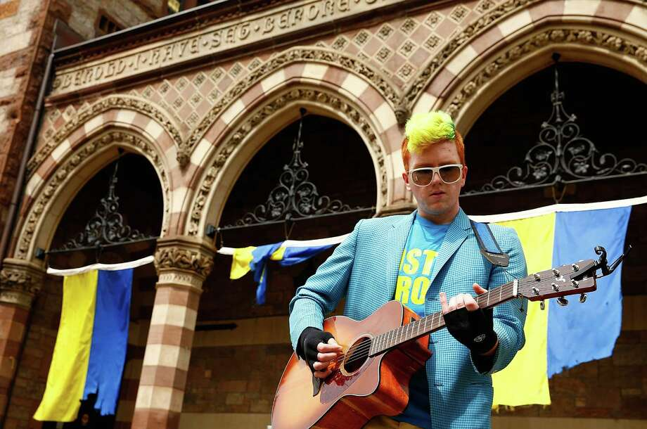 BOSTON, MA - APRIL 15: Tim Sorbanelli, 21, a Berklee College of Music student, plays his guitar near the finish line of the Boston Marathon prior to the flag raising ceremony commemorating the one-year anniversary of the Boston Marathon bombings on Boylston Street near the finish line on April 15, 2014 in Boston, Massachusetts.  (Photo by Jared Wickerham/Getty Images) ORG XMIT: 485055841 Photo: Jared Wickerham, Getty / 2014 Getty Images